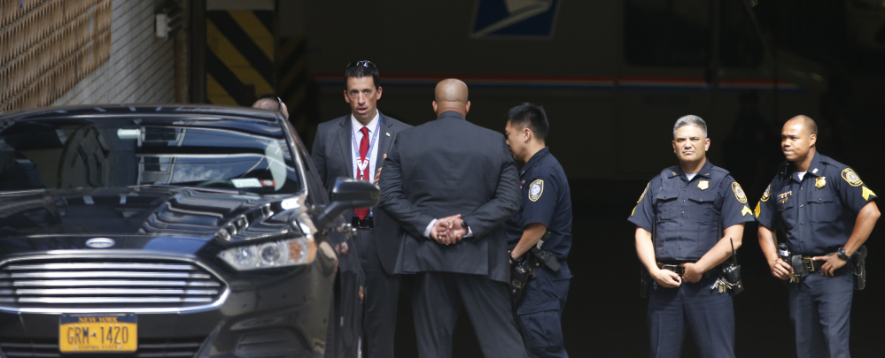 Police and security for Donald Trump gather Wednesday in a parking garage beneath the Jacob K. Javits Federal Building in Lower Manhattan in New York.