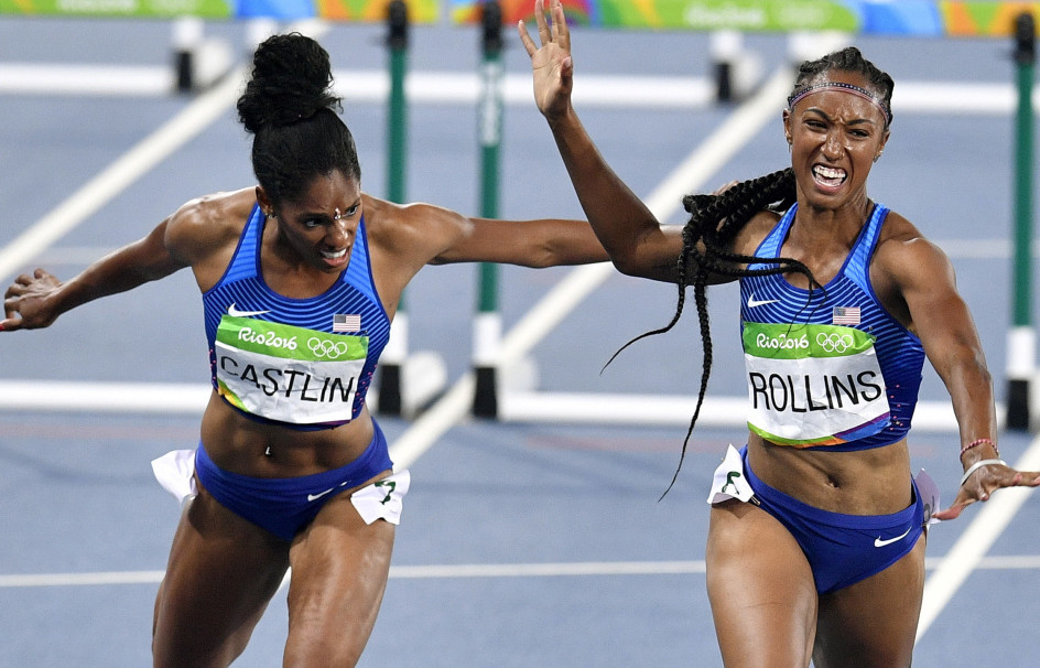 Brianna Rollins of the United States, right, wins the gold medal in the women's 100-meter hurdles Wednesday night. Kristi Castlin of the U.S., left, was third as the Americans swept the event.
