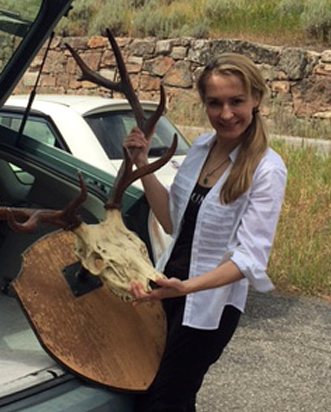Anita Thompson returns trophy antlers to the former home of writer Ernest Hemingway on Aug. 5.