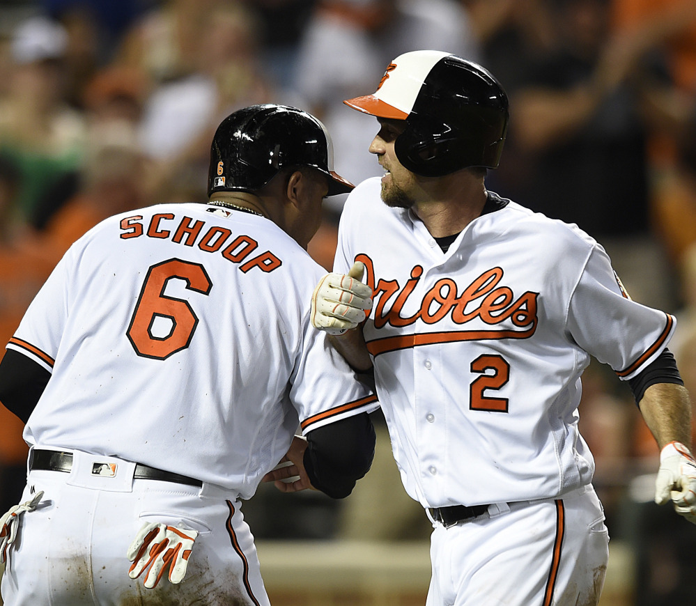 Baltimore's J.J. Hardy, right, celebrates his two-run homer with Jonathan Schoop, who also scored on the play, in the fourth inning of the Orioles' 13-5 victory over Houston at home. Baltimore matched a season high in runs scored.