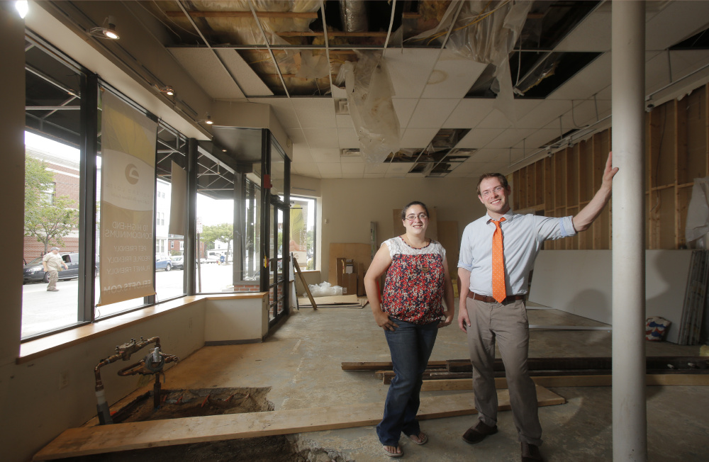 Emily Russo and Josh Christie stand in the East End space, formerly occupied by the Angela Adams retail store, that will house Print: A Bookstore.