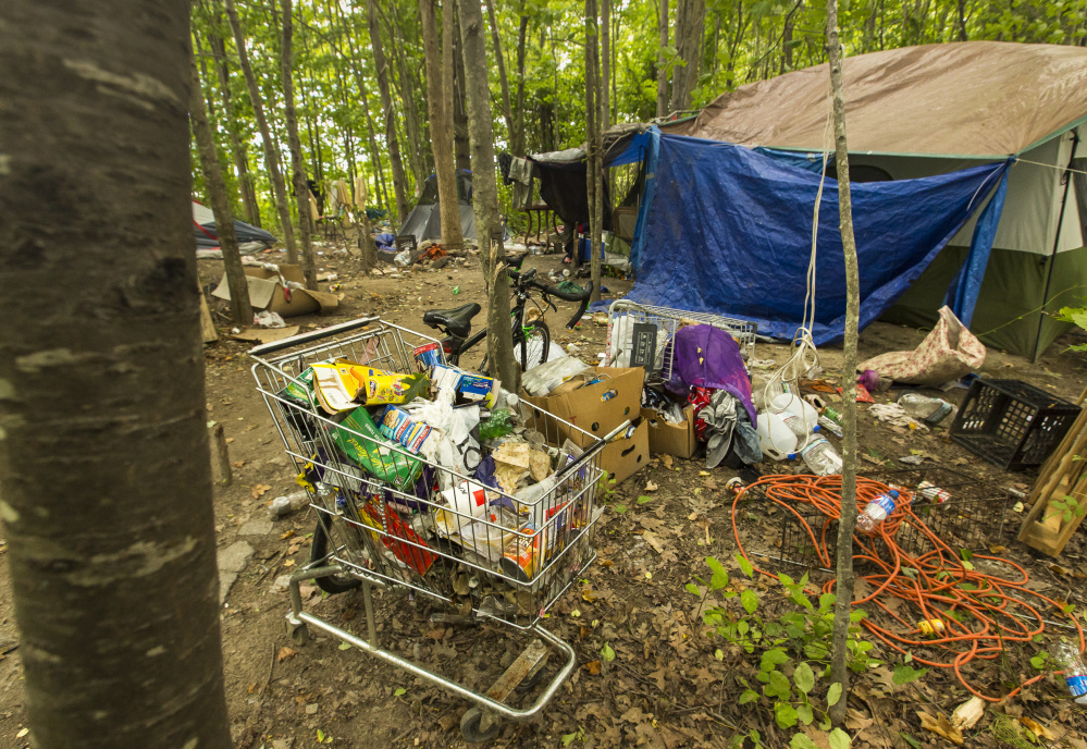 Campers at this tent site in a wooded area near Lowe's on Brighton Avenue in Portland face eviction by the city by the end of this month.