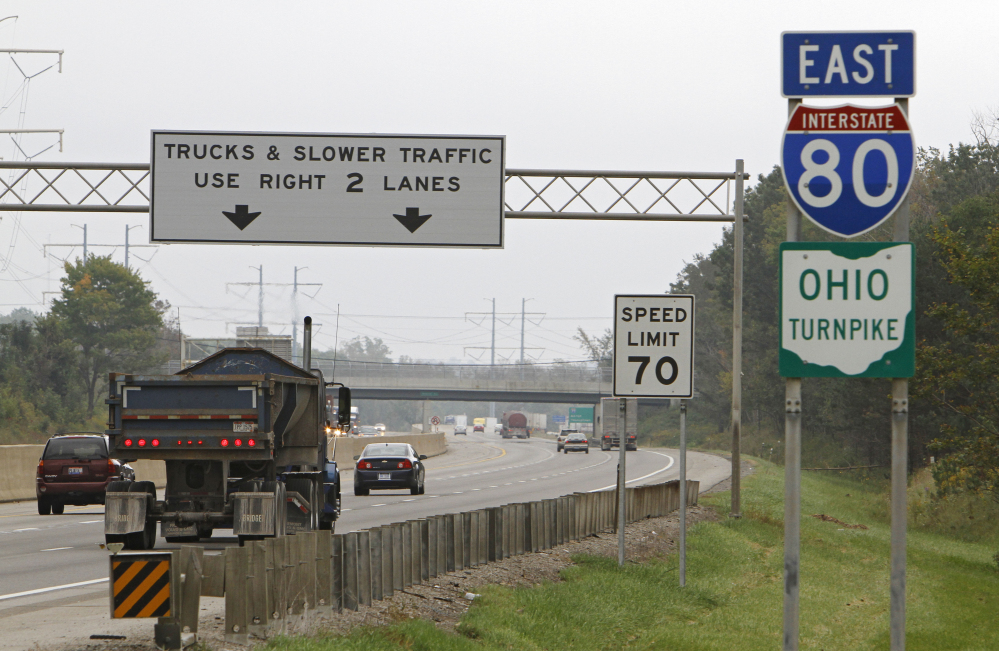 In this Sept. 29, 2011, file photo, vehicles drive along the Ohio Turnpike in Strongsville. Ohio Turnpike Executive Director Randy Cole said testing of self-driving vehicles could begin on the toll road in late 2016 or in 2017. Cole says the route that takes Interstate 80 from Pennsylvania to Indiana is set up well for testing autonomous vehicles because it already has a fiber-optic network along the entire roadway.