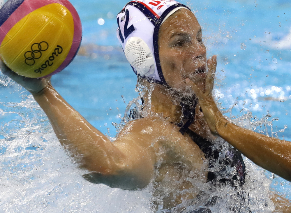 United States' Kami Craig takes a shot as Italy's Federica Radicchi defends during women's gold medal water polo match at the 2016 Summer Olympics in Rio de Janeiro, Brazil, on Friday. Associated Press/Sergei Grits