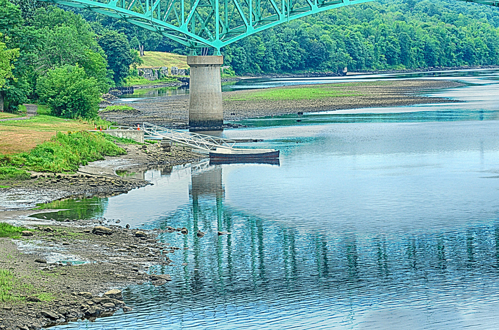 This Wednesday photo shows low tide on the Kennebec near Memorial Bridge in Augusta.