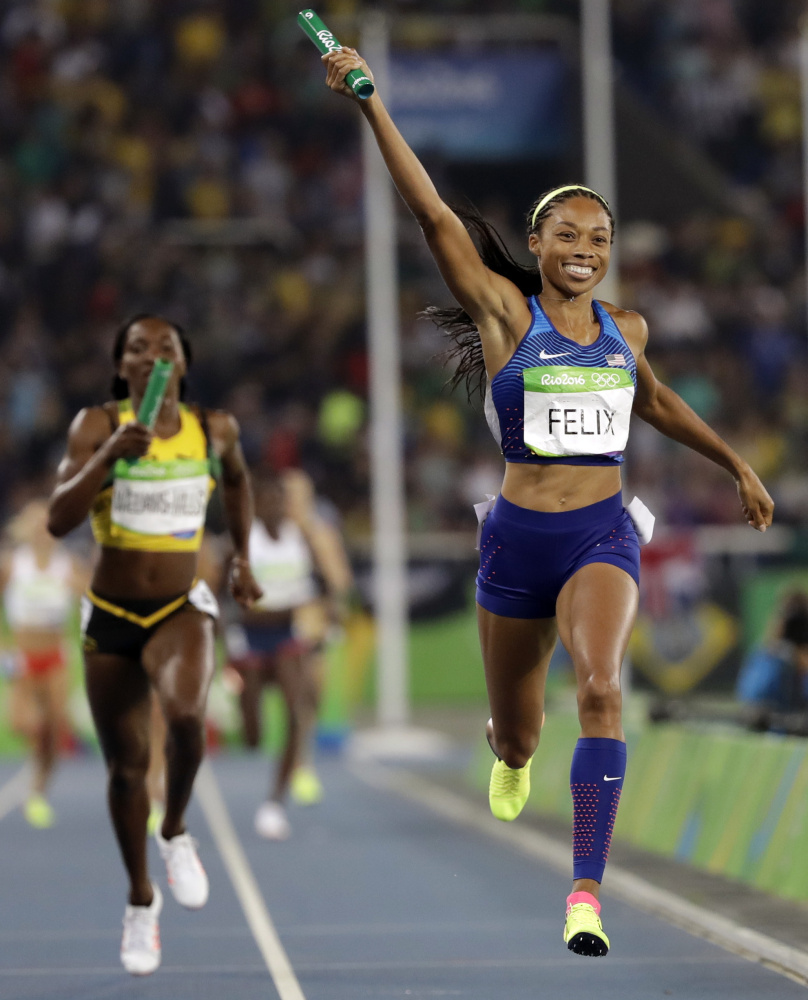 Allyson Felix of the U.S. celebrates as she crosses the finish line of the 1,600-meter relay, earning a record sixth career gold medal.