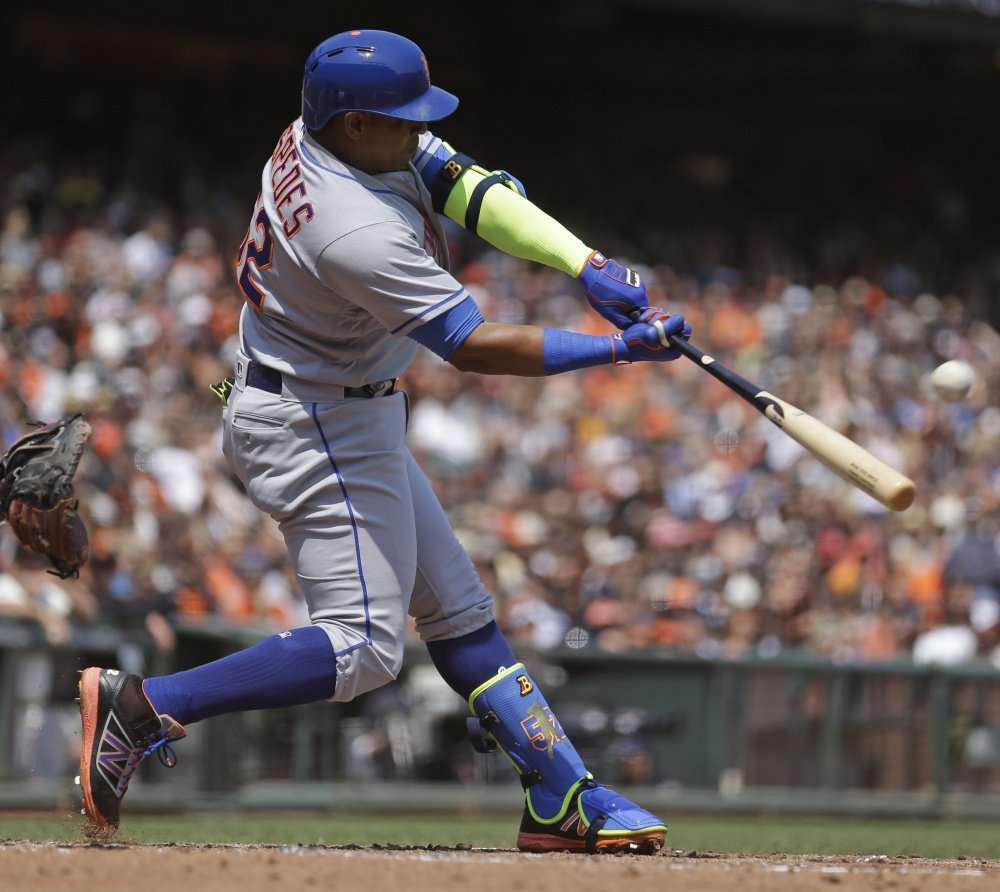 Yoenis Cespedes of the Mets connects for a home run off Giants starter Matt Moore in the third inning – his first of two homers Saturday in a 7-2 road victory.