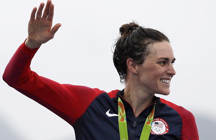 Gwen Jorgensen of the United States waves after receiving the gold medal for the women's triathlon  on Copacabana beach in Rio de Janeiro, Brazil, on Saturday.