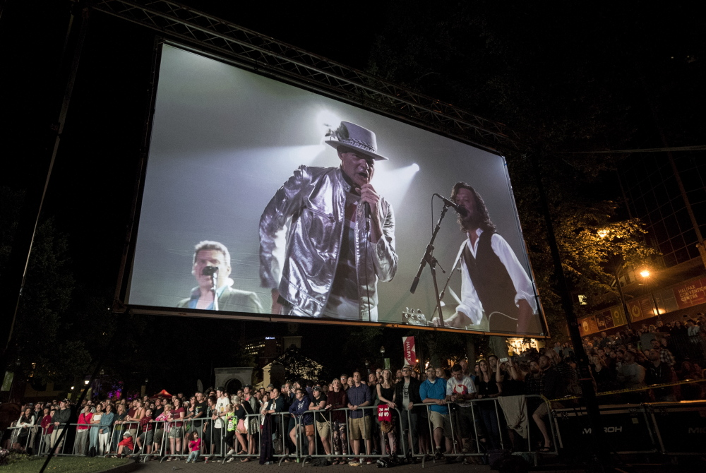 The Tragically Hip's frontman Gord Downie is displayed on a screen during a public viewing of the band's final concert Saturday.