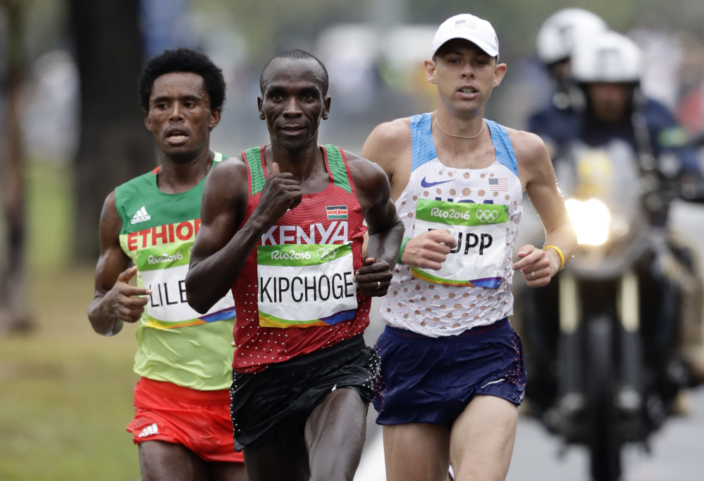 Eliud Kipchoge of Kenya leads Feyisa Lilesa of Ethiopia and Galen Rupp of the U.S. late in the marathon before pulling away to win in a time of 2 hours, 8 minutes, 44 seconds. Lilesa took the silver medal and Rupp won bronze. Associated Press/Robert F. Bukaty