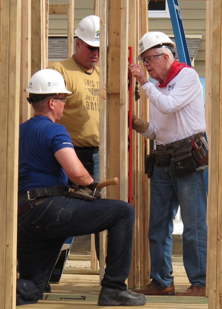 Former President Jimmy Carter works on a Habitat for Humanity project Monday. Carter said he thought he had just a few weeks to live during his battle with cancer.