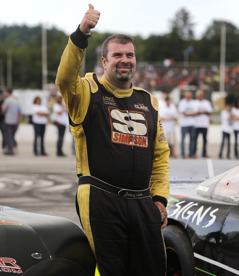 Johnny Clark of Hallowell gives the thumbs up to fans before the 2014 Oxford 250. Clark is still searching for his first victory in the race.