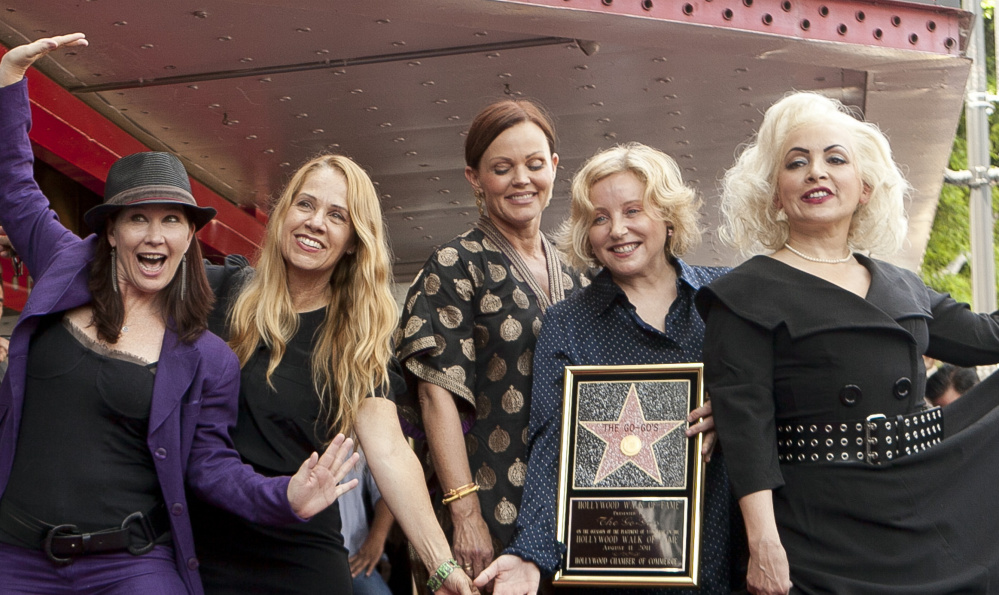 The Go-Go's were Kathy Valentine, from left, Charlotte Caffey, Belinda Carlisle, Gina Schock and Jane Wiedlin in 2011. Valentine left the band in 2013.