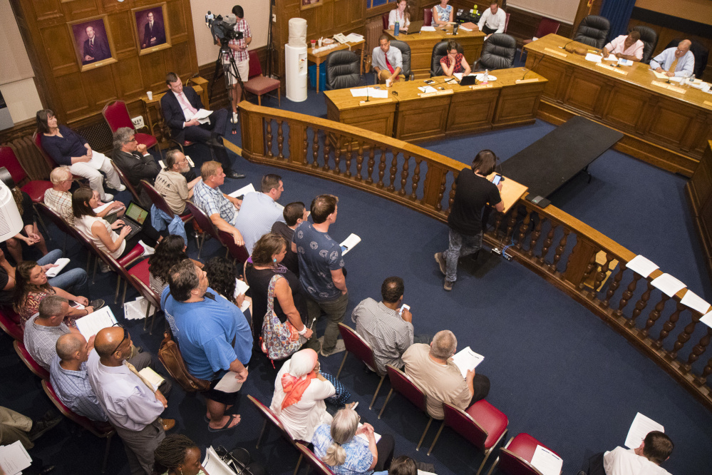 Members of the public speak at a meeting Wednesday of the City Council's Housing Committee, which heard proposals from Portland's mayor and two councilors. The panel is expected to take formal action beginning Sept. 14.