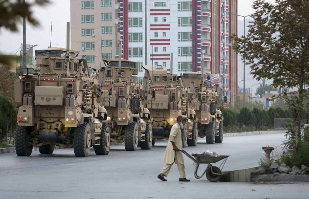 Military vehicles guard the American University of Afghanistan in Kabul on Thursday, a day after an attack there left 13 dead.