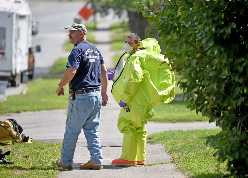 Waterville firefighters and other emergency personnel respond to a report of a chemical spill Thursday at a multi-family apartment building at 270 Main St. in Waterville. The call turned out to be over-use of a bug repellent containing diatomaceous earth.