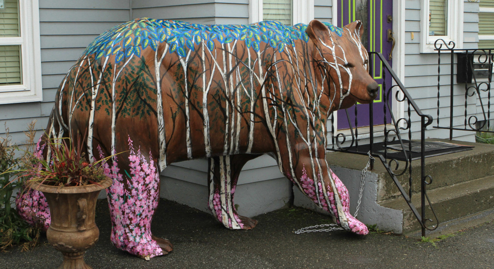 Birch forest and northern flora decorate the bear in front of All About You Medical Spa.