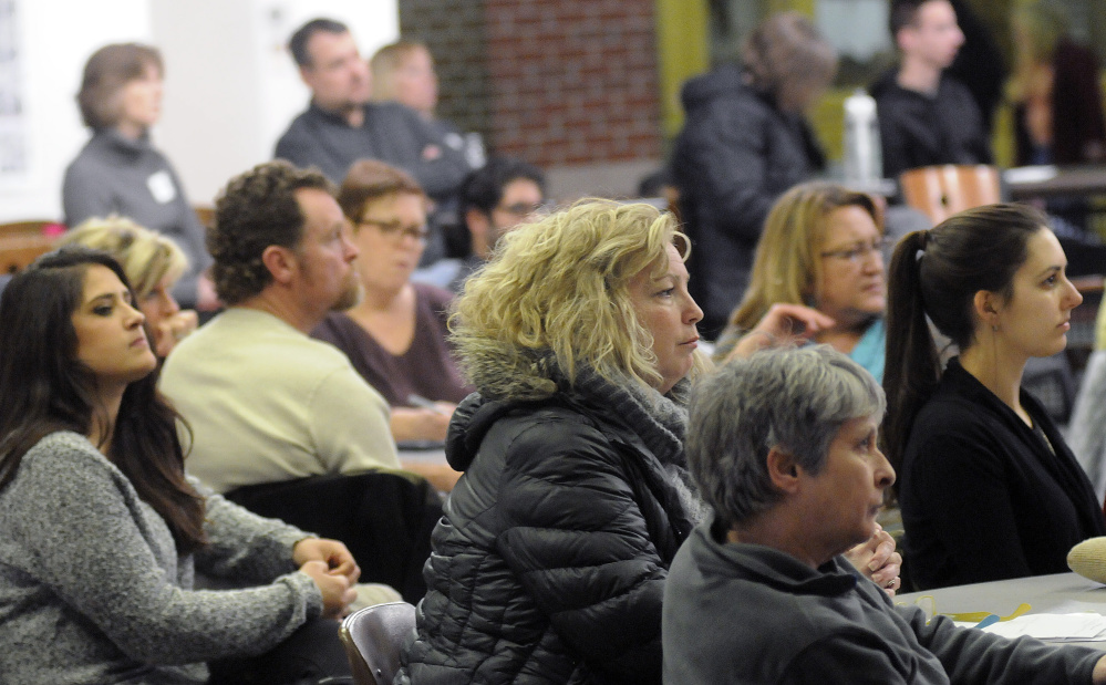 People attending a Jan. 11 forum about drugs listen to speakers at Cony High School in Augusta. A local health agency plans to host two more drug-related forums Monday and Tuesday in Gardiner and Augusta, respectively.