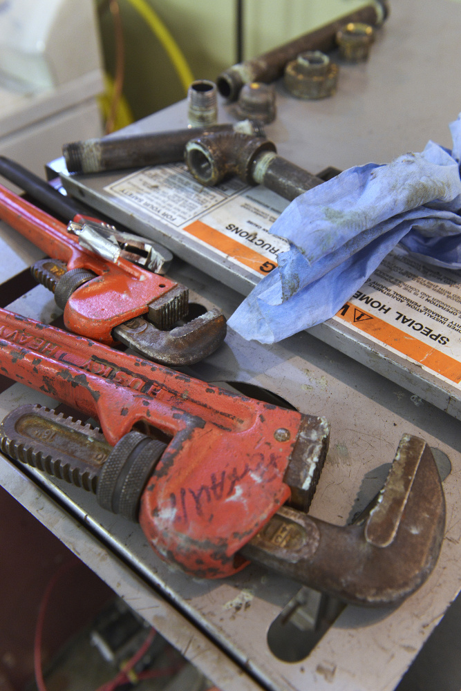 Wrenches and rags are tools of the trade at the Technical Education Center in Brunswick.