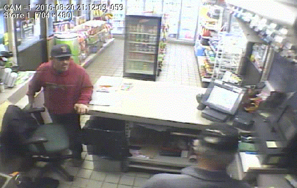 Courtesy of Portland Police Department This image taken from security video shows the man who robbed the ScrubaDub car wash in Portland on Aug. 20.