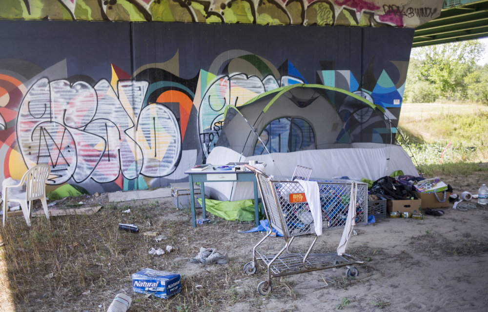 A campsite in the 30 acres off Brighton Avenue where homeless people stay contains a tent and other items. Some camps have wooden structures, fire pits or gardens. Brianna Soukup/Staff Photographer