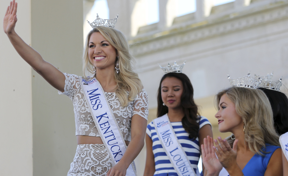 Miss Kentucky, Laura Jones, waves as she is introduced during the Miss America Pageant arrival ceremonies Tuesday in Atlantic City, N.J.