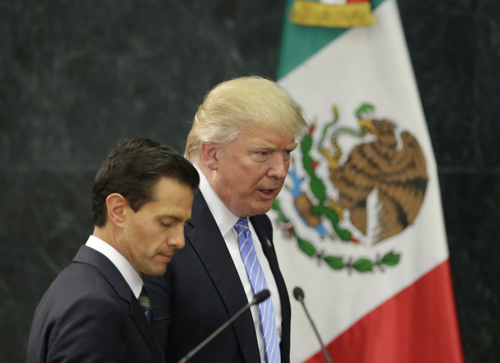 Donald Trump and Mexico's President Enrique Pena Nieto arrive for their press conference Wednesday at the Los Pinos residence in Mexico City.
