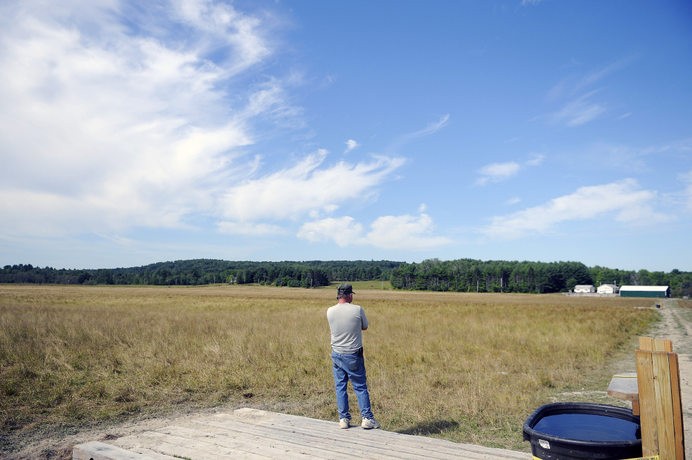 Pete Kelley surveys a pasture Tuesday in Pittston.