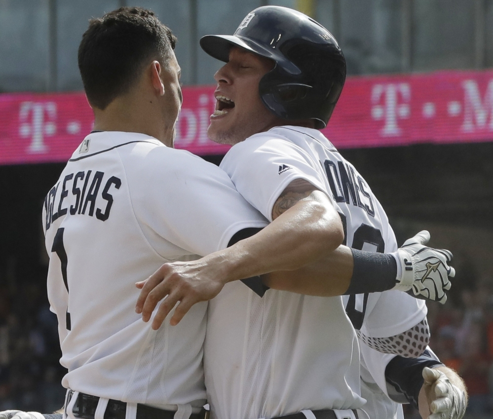 Detroit's JaCoby Jones, right, is greeted by teammate Jose Iglesias after scoring the winning run in a 3-2 victory over the White Sox at Chicago on Wednesday.