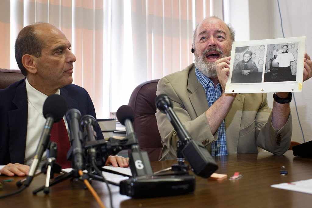 Attorney Mitchell Garabedian, left, with victim Lawrence Gray who was abused beginning in 1958. Gray spoke during the press conference and showed a picture of himself around the ages of 11 or 12.