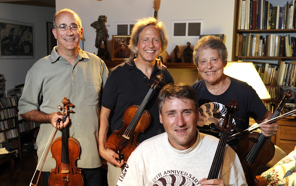 The Portland String Quartet – Dean Stein, 1st violin; Ronald Lantz, 2nd violin; Julia Adams, viola; and Patrick Owen, cello (front) – is celebrating its 30th anniversary. Gordon Chibroski/Staff Photographer