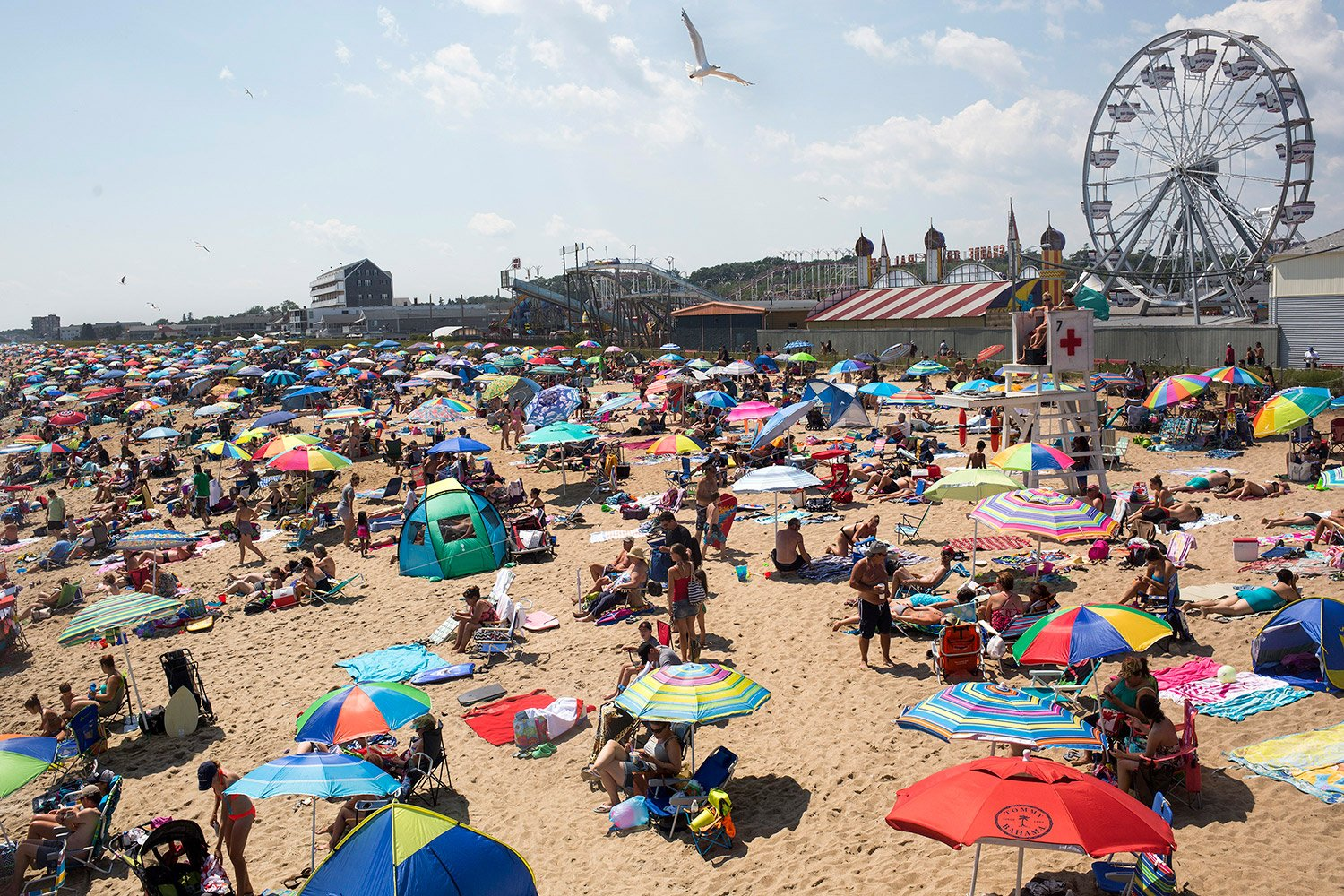 Even in what is perceived to be a down year for Canadian tourists, the beach is packed at noon on one recent summer day. A clerk at the nearby Inn at Soho Square said the slumping Canadian economy had opened the door to a new wave of first-time American guests.