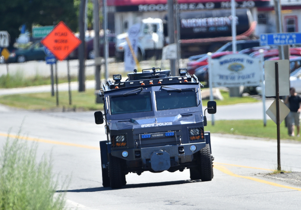 Maine State Police and other law enforcement agents respond to a report of an armed man threatening suicide in the parking lot at Wal-Mart in Palmyra on Friday.