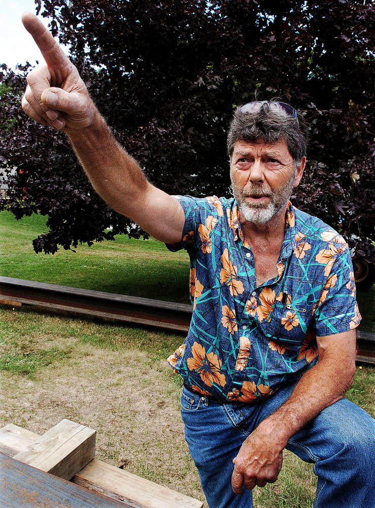 Skowhegan School of Painting and Sculpture grounds and maintenance supervisor Bill Holmes points to where Paco the parrot flew away Thursday.