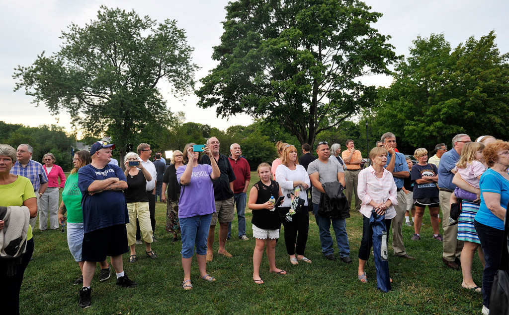 People gather in Riverbank Park in Westbrook on Wednesday evening for a