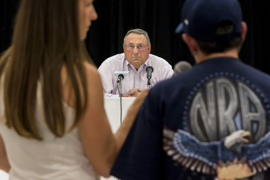 Gov. Paul LePage listens to a question about heroin addiction from Sanford resident Marge Trowbridge, right, during a town hall-style meeting at Sanford High School. LePage's press secretary, Adrienne Bennett is at left. (Photo by Ben McCanna/Staff Photographer)