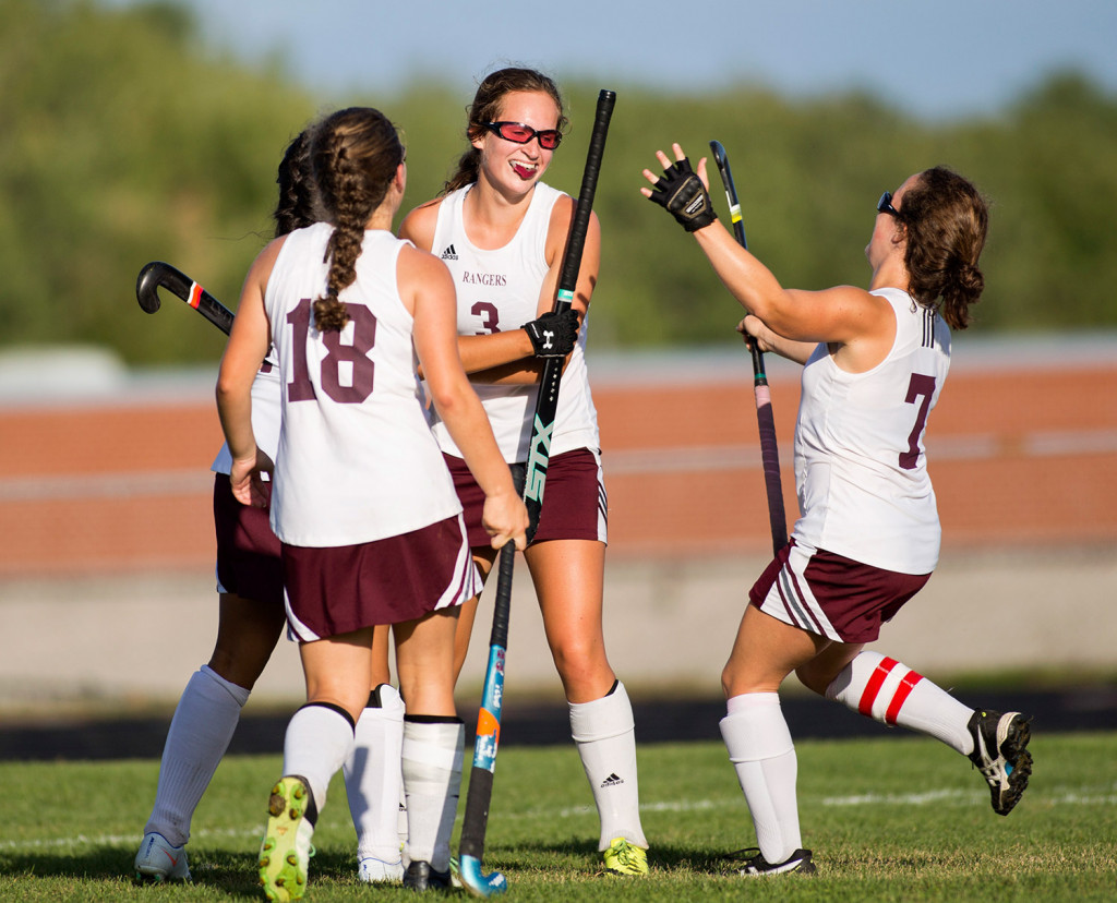 Greely players run up to hug sophomore Maddy Perfetti (3) after she scored the winning goal in overtime against Lake Region. Greely won 3-2. Brianna Soukup/Staff Photographer