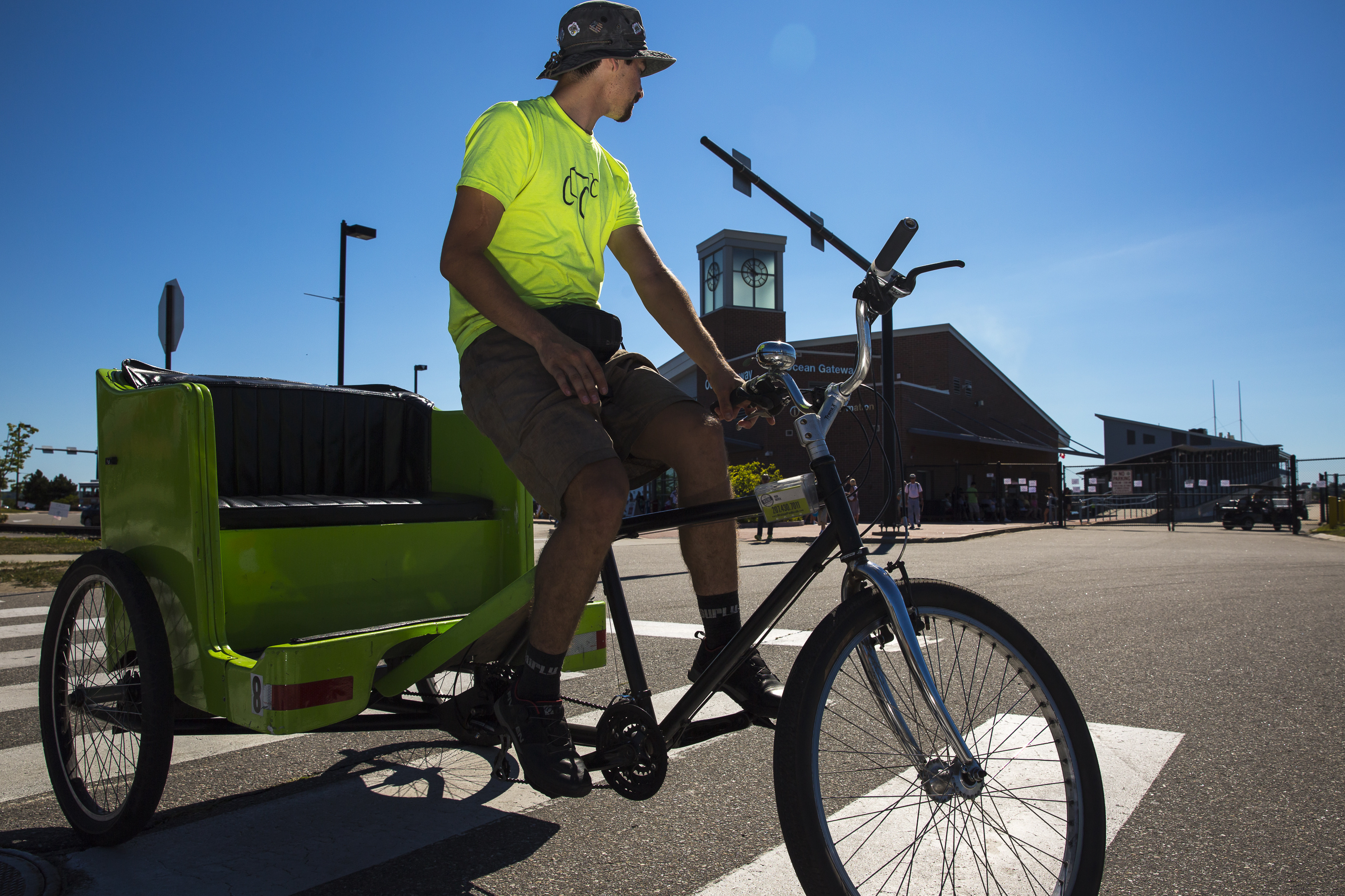 Colton Sanders, a driver for Maine Pedicab, awaits a fare as passengers from the cruise ship Grandeur of the Seas exit Ocean Gateway. Ben McCanna/Staff Photographer