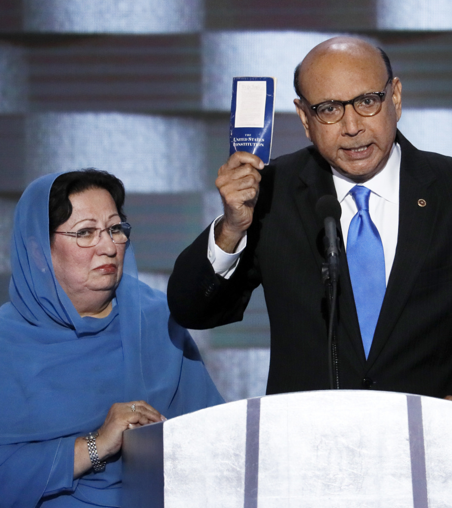 Khizr Khan, father of fallen U.S. Army Capt. Humayun S.M. Khan, holds up a copy of the U.S. Constitution at the Democratic National Convention in Philadelphia on Thursday. Associated Press/J. Scott Applewhite