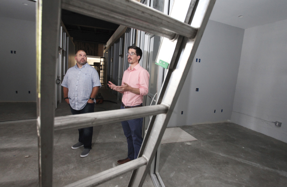 Jess Knox, left, founder of Maine Startup and Create Week, and partner Mike Sobol show off the space for Venture Hall, which is in the yet-to-open co-working space Cloudport.