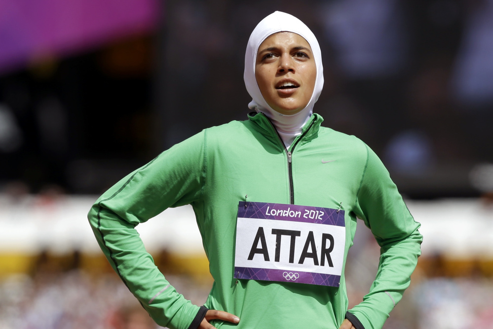 Sarah Attar reacts after competing for Saudi Arabia in a women's 800-meter heat in the 2012 London Olympics. Forget the last-place finish – Attar joined judoka Wojdan Shaherkani as Saudi Arabia's first female Olympians.