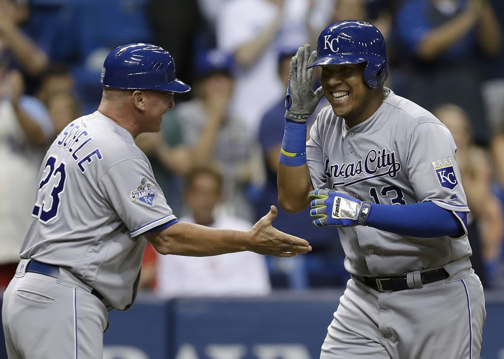 Salvador Perez, right, celebrates with third base coach Mike Jirschele after hitting a go-ahead two-run homer in the seventh inning against Tampa Bay on Tuesday in St. Petersburg, Fla.
