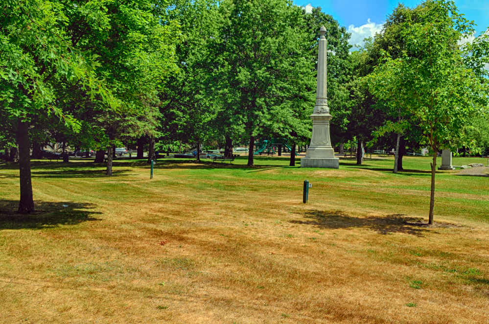This Wednesday photo shows brown grass near the Civil War Memorial on Gardiner Common, one of the local public spaces showing signs of the dry weather.