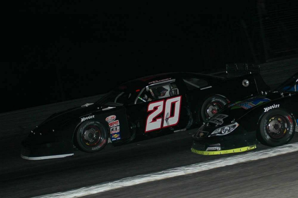 Mike Landry (20) races in the Pro All Stars Series H.P. Hood 150 on Sunday at Oxford Plains Speedway. Landry finished third for his first career top five finish in the series.