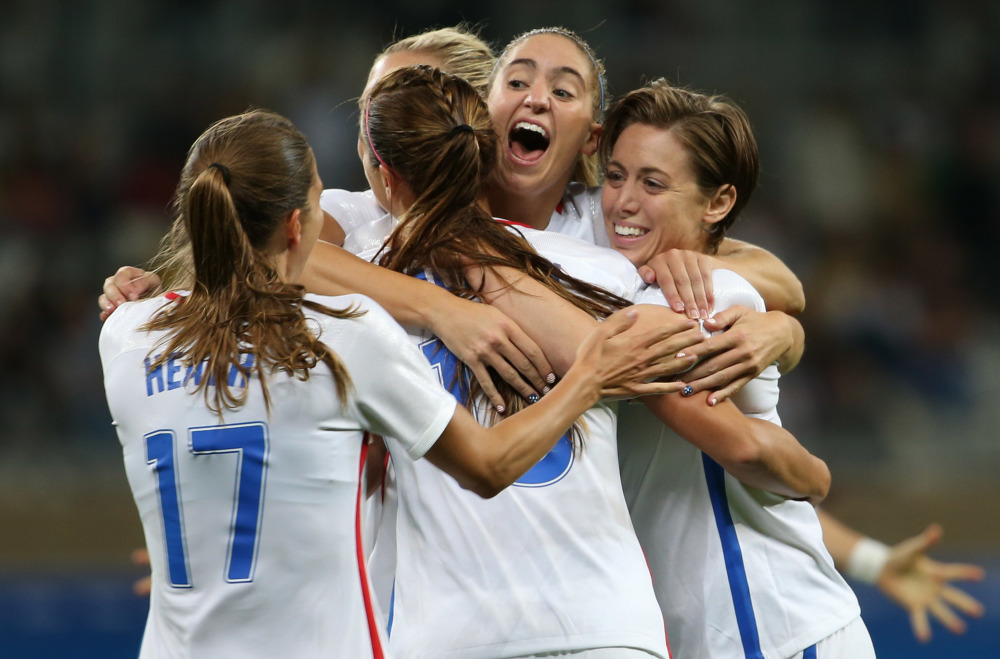United States players celebrate Wednesday after Alex Morgan scored a second-half goal that finished off a 2-0 victory against New Zealand in an Olympic opener.
