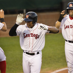 Portland Sea Dogs player Ryan Court celebrates Rainel Rosario's fourth-inning grand slam against Erie at Hadlock Field in Portland on Wednesday. Sea Dogs outfielder Cole Sturgeon, also knocked home on the play, smiles in the background at right. Portland held on for a 5-4 win.