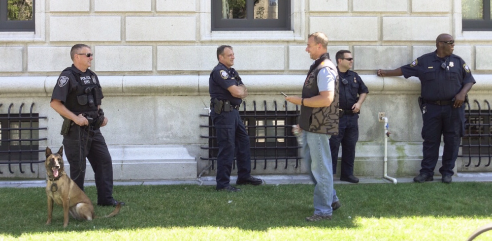 Five Department of Homeland Security officers stand guard in front of the Edward T. Gignoux U.S. Courthouse in Portland while Espen Brungodt made an initial appearance Thursday in U.S. District Court. Brungodt is facing a felony charge of sending threatening interstate communications.