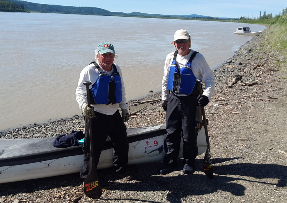 Terry Wescott, left, of Thorndike and Brad Krog, right, of Bowdoin stand ashore beside the Yukon River near Fairbanks, Alaska, after finishing the Yukon 1000 and becoming the first canoe team, as well as the oldest team, to win the endurance wilderness race.