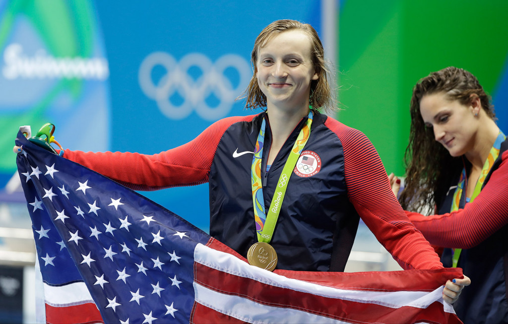 Katie Ledecky of the U.S. celebrates with her medal after the women's 400-meter freestyle during the swimming competitions at the 2016 Summer Olympics. Associated Press/Matt Slocum