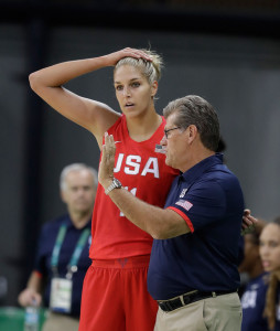 Guard Elena Delle Donne talks with head coach Geno Auriemma during the first half of a women's basketball game on Monday.